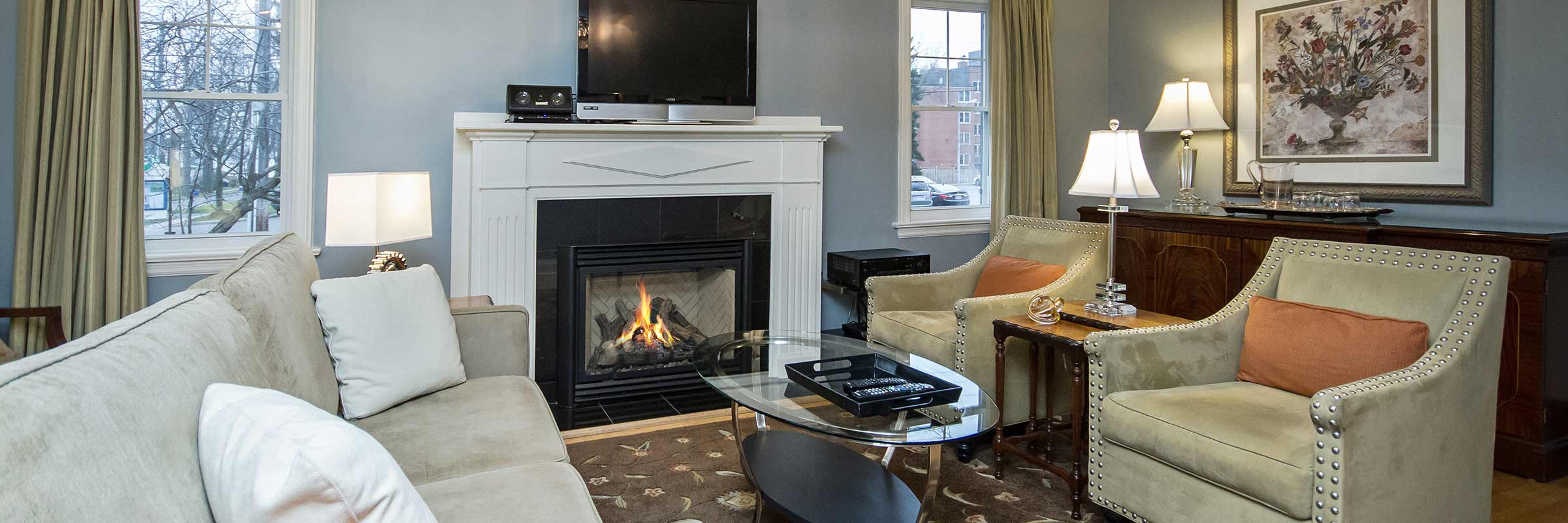Booking this 2 bedroom apartment in downtown Burlington with fireplace glowing and lush comfortable easy chairs
