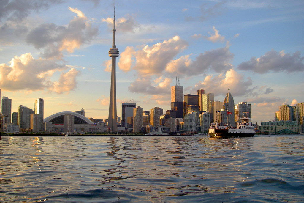 View of downtown Toronto from Lake Ontario with CN Tower and the Dome