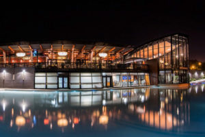Night photo of Spencer's restaurant with reflections on pond