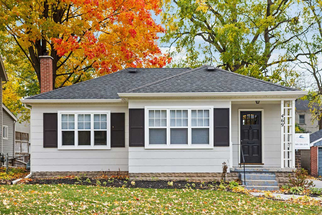 Exterior of a renovated bungalow in downtown Burlington on a beautiful fall day