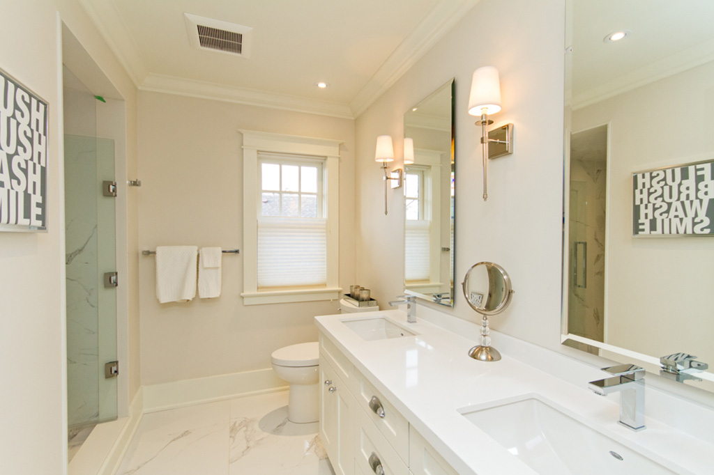 Walk-in shower and double sink vanity in Tudor House suite 1 furnished rental in downtown Burlington