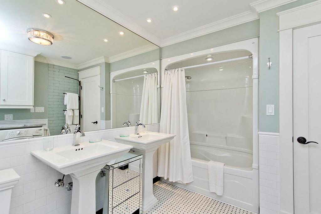 Main bathroom with two vanities of Burlington Lakeshore home rental.