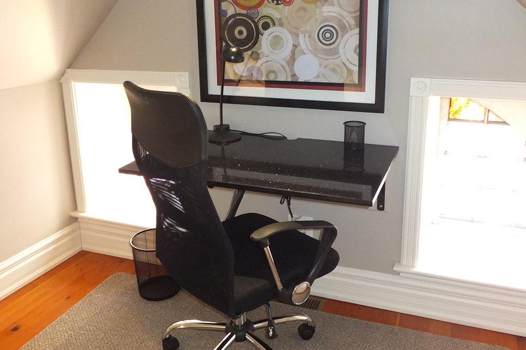 Desk area in suite 4 of the Gingerbread House in Burlington.