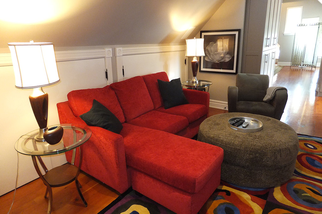 Red sofa in suite 4 of the Gingerbread House in Burlington.